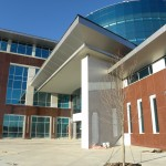 AAS Case Study | Higher Education Complex | Cast Stone Provided Partitions to Windows, Created Main Door Entry