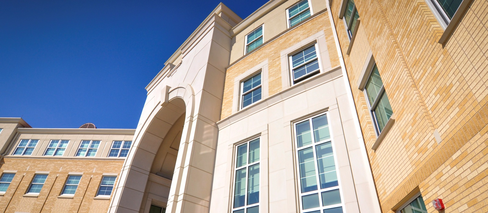 AAS Case Study - TCU Worth Hills - Large Size Custom Shape Cast Stone Panels for Architectural Design
