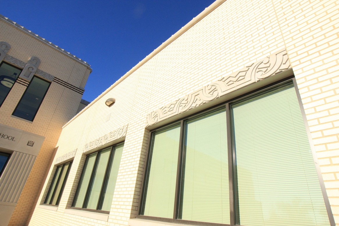 Advanced Architectural Stone (AAS Formerly ACS) | Art Deco Design style design using Cast Stone, Architectural Precast | North Side High School | Close up Window Header | Architect: Corgan Associates | Contractor: Steele-Freeman, Inc. Contractors