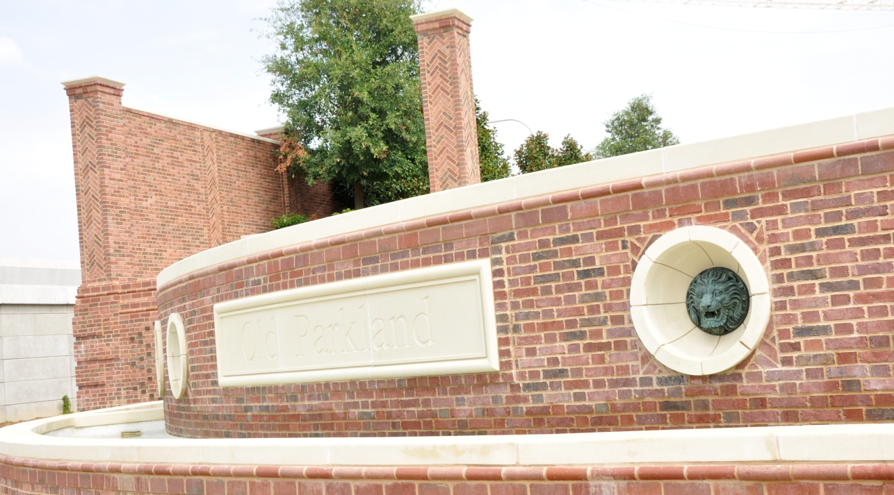 Old Park Land Exterior Hardscape | Wall Coping, Signage, Column Capitals | Designed Contrast with Brick Work