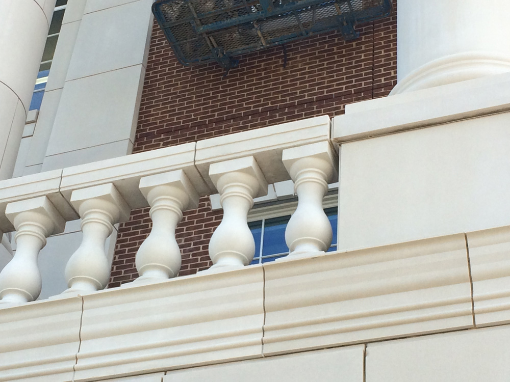 Architectural cast stone balustrade system, wall coping | Front elevation cladding at SMU Simmons Hall