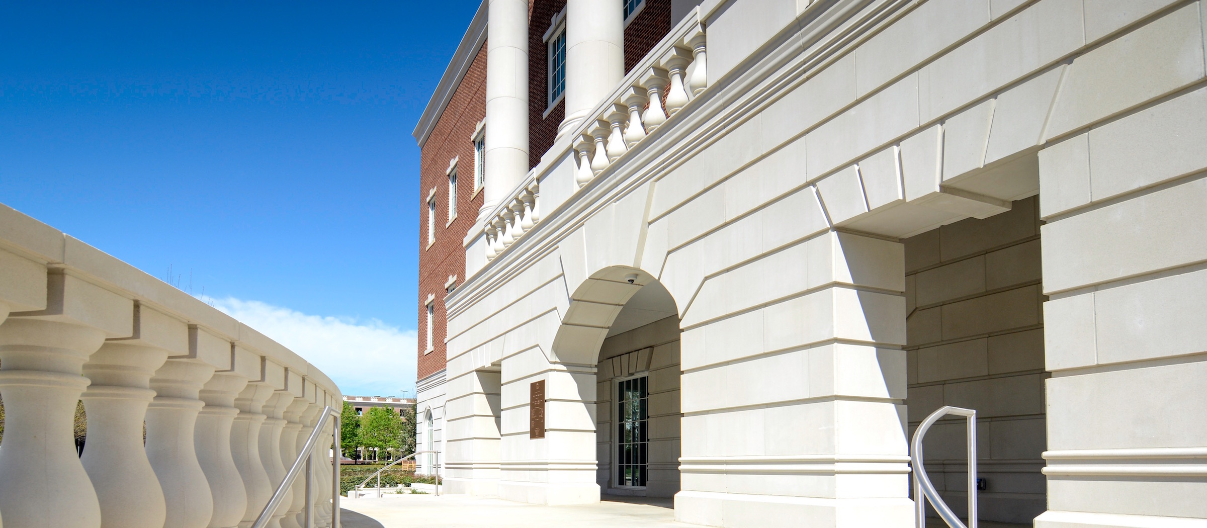 SMU Simmons Hall | Wilks Masonry | Fabricated Stone Panels Cladding, Coping, Veneer, Balusters, Columns