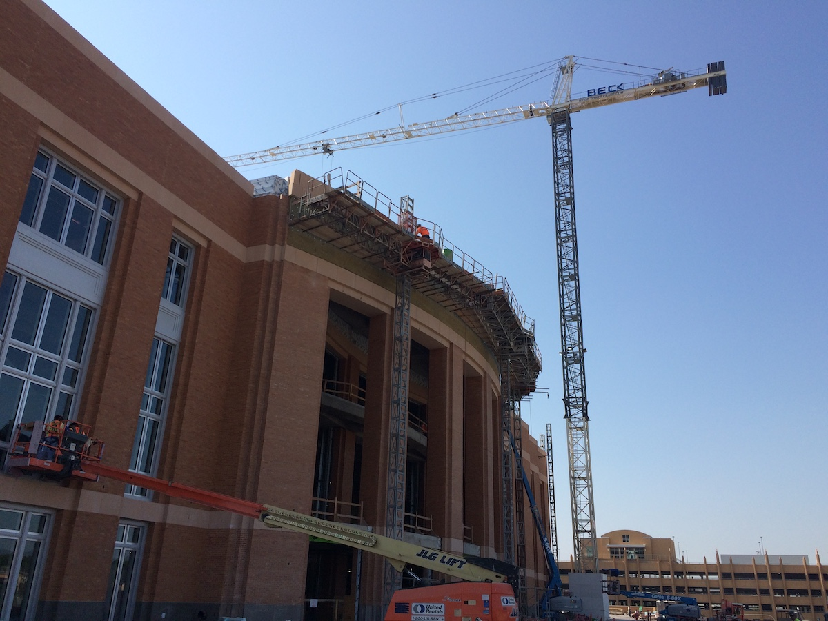 Large size cast stone pieces for banding, wall coping all around the Ft Worth Arena