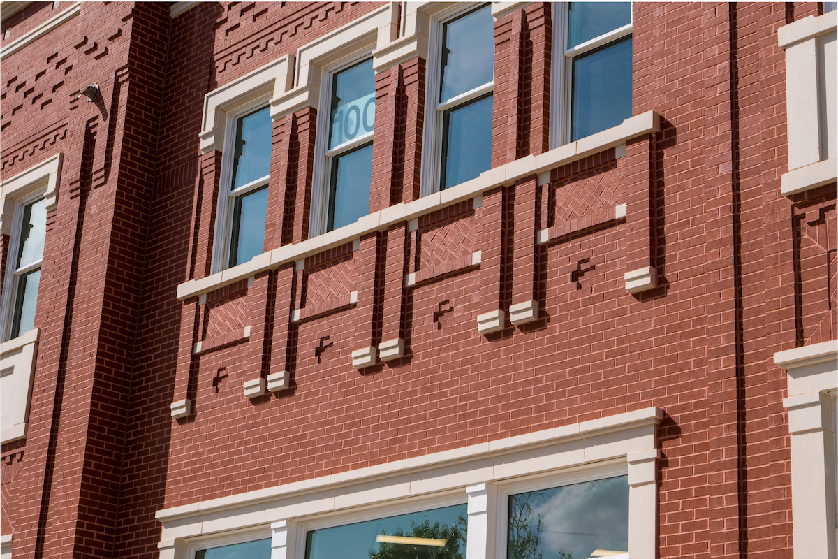 Detailed design work in brick highlighted by cast stone